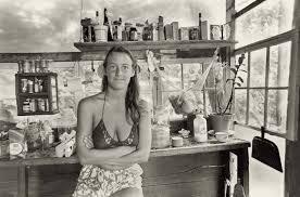 woman hippie commune kitchen